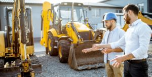 Two Men in a Construction Equipment Rental Yard